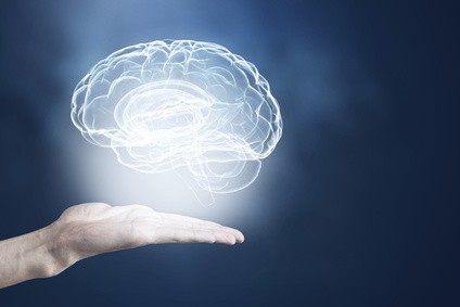 Male hands holding image of human brain