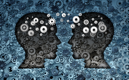 Training neuroscience development concept as a group of cog wheels and gears shaped as human heads with information transfer as a technology brain symbol or psychology exchange success.